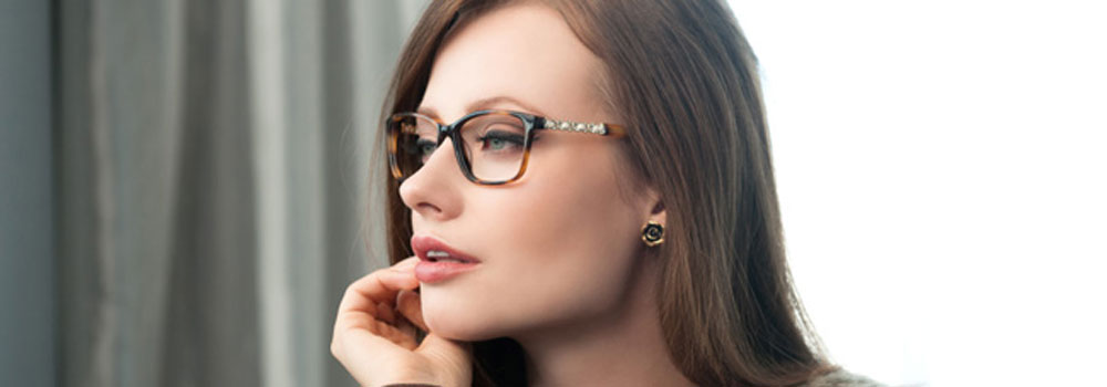 woman looking at wide variety of premium glasses frames